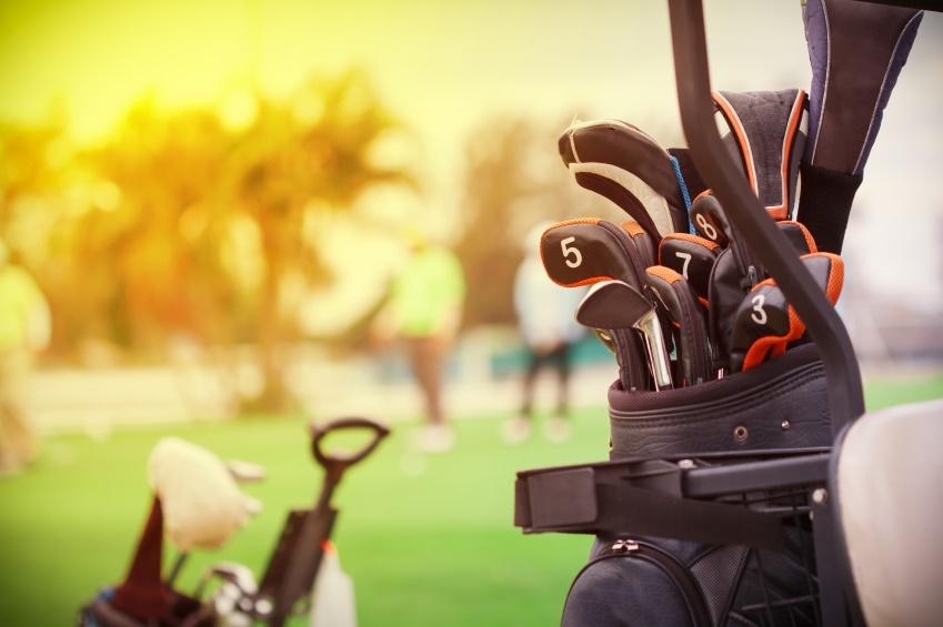 closeup of golf club in bag on golfer background
