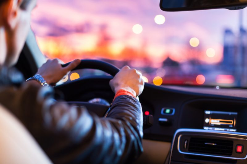 Driving a car at night -man driving his modern car at night in a