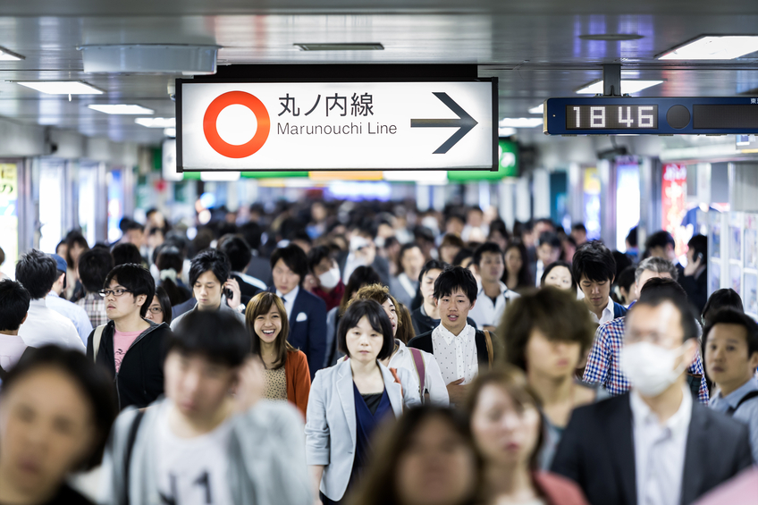 Tokyo, Japan - May 16, 2014: Passengers hurry at Ikebukuro station in Tokyo, Japan. Ikebukuru is the second-busiest railway station in the world