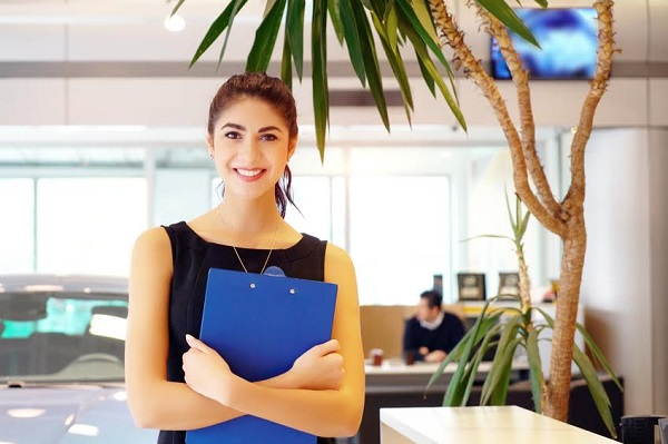 saleswoman ready to welcome customer in the showroom