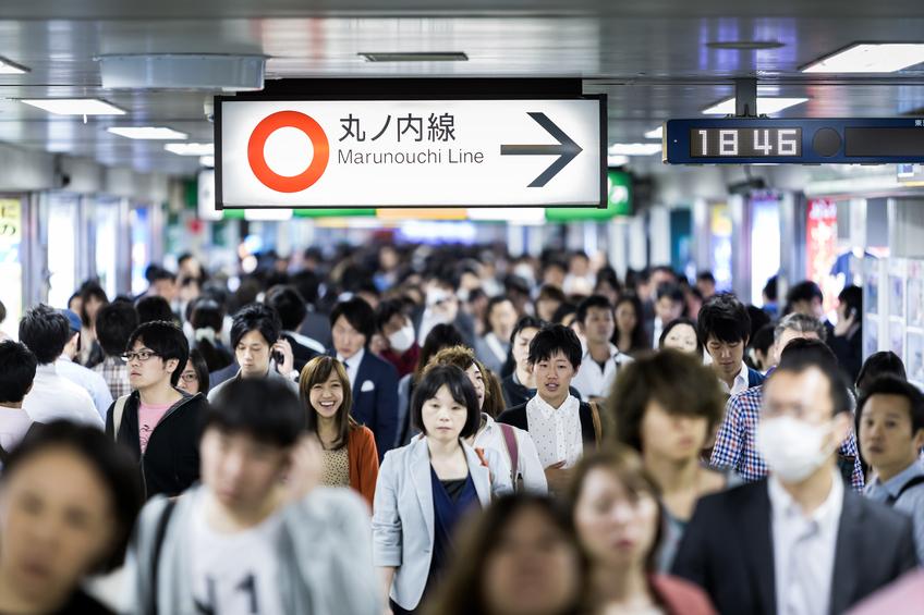 Tokyo, Japan - May 16, 2014: Passengers hurry at Ikebukuro station in Tokyo, Japan. Ikebukuru is the second-busiest railway station in the world