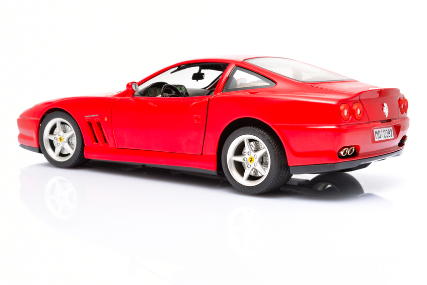 Kampen, The Netherlands - July 20, 2012: Red Ferrari 550 Maranello modell car isolated on a white background in a studio.