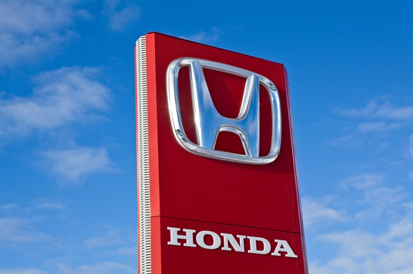 Jyvaskyla, Finland - March 12, 2011: A Honda Motor Company, Ltd. sign at a car dealers yard. Honda Motor Company, Ltd. is a Japanese multinational corporation primarily known as a manufacturer of automobiles and motorcycles