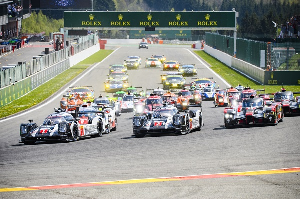 Spa, Belgium - May 7, 2015: Race start of the 2016 Six Hours of Spa of the FIA World Endurance Championship at the Spa-Francorchamps race track. The Porsche 919 Hybrid race cars are leading the Toyota TS050 and Audi R18 LMP1 cars in front of the rest of the field of LMP and LM GTE race cars. The car is driving around the Spa Francorchamps race track during the WEC 6 Hours of Spa-Francorchamps. The team participates in the 2016 FIA World Endurance Championship (WEC).