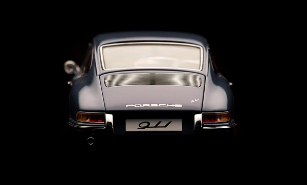 Beaconsfield, UK - February 22, 2016: A 1:18 scale model of a 1964 Porsche 911 made by Auto Art, set against a solid black background. Low key image of the back end of the car.